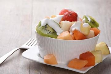Fresh fruits salad with whipped cream